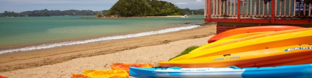 Kayaks on beach, Paihia, Bay of Islands, Northland, North Island, New Zealand