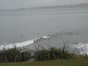 Surfing at Raglans Whale Bay